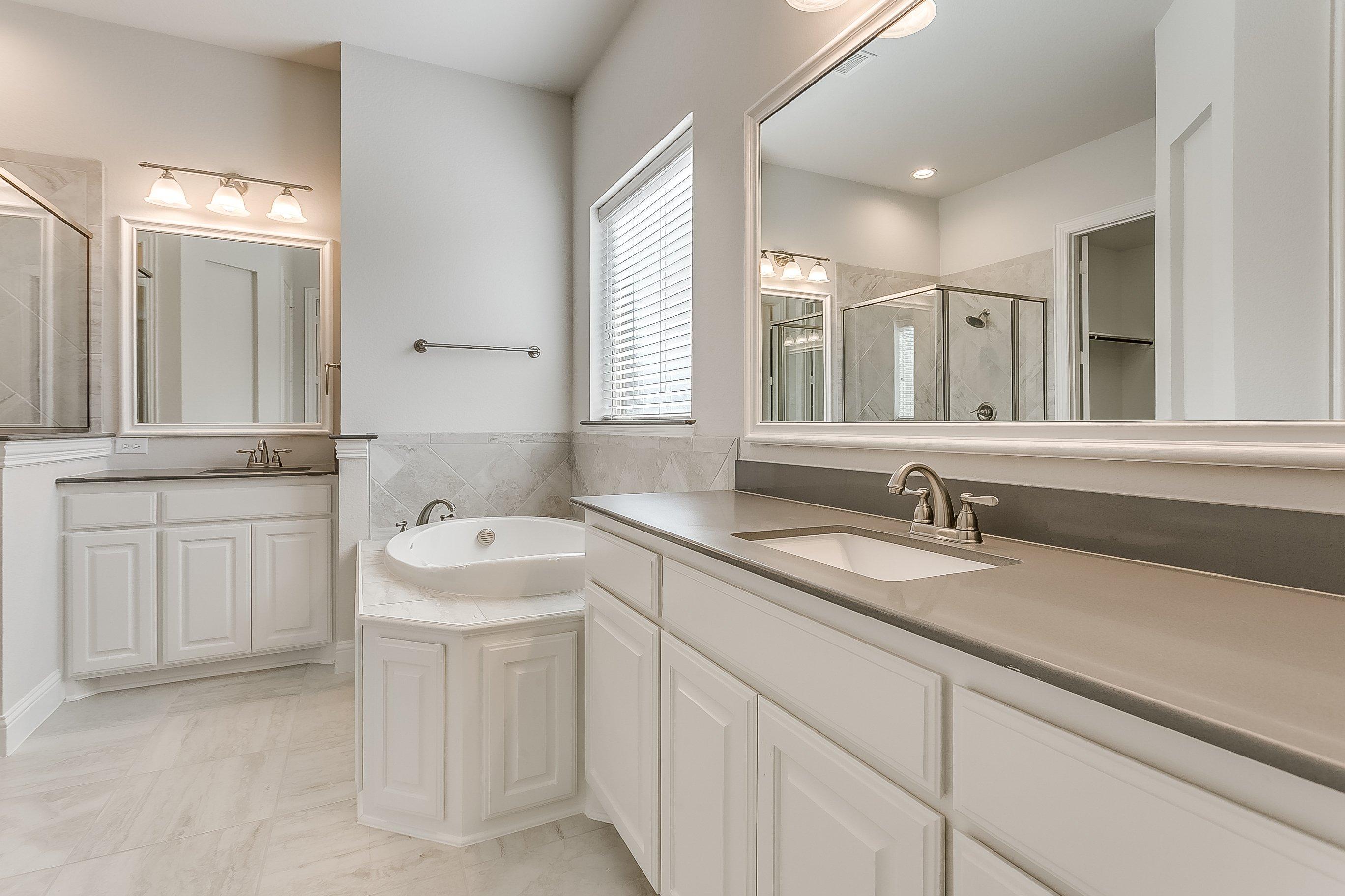 1113 Autumn Trail - John Houston Custom Homes - Master Suite, Master Bathroom, Quartz Countertops, Grey Bathroom, White Cabinets, His and Hers Sinks