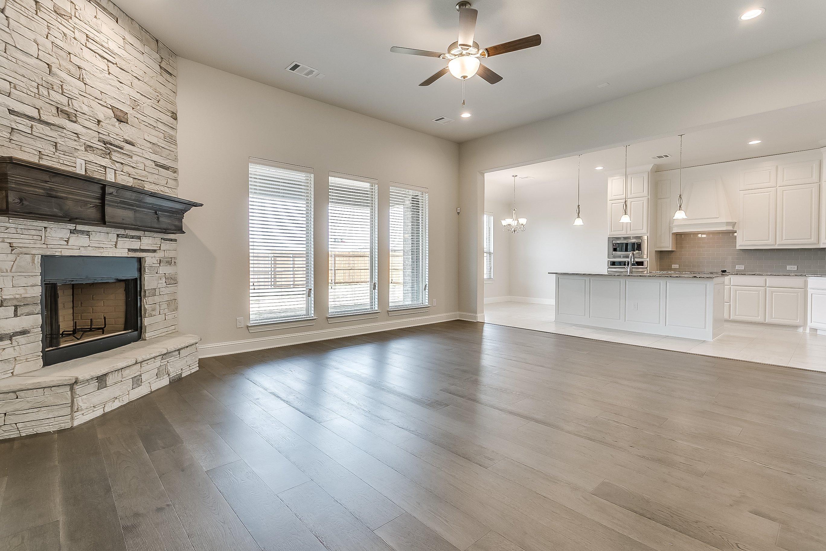 1113 Autumn Trail - John Houston Custom Homes - Fireplace, Living Room, Kitchen, Wood Floors