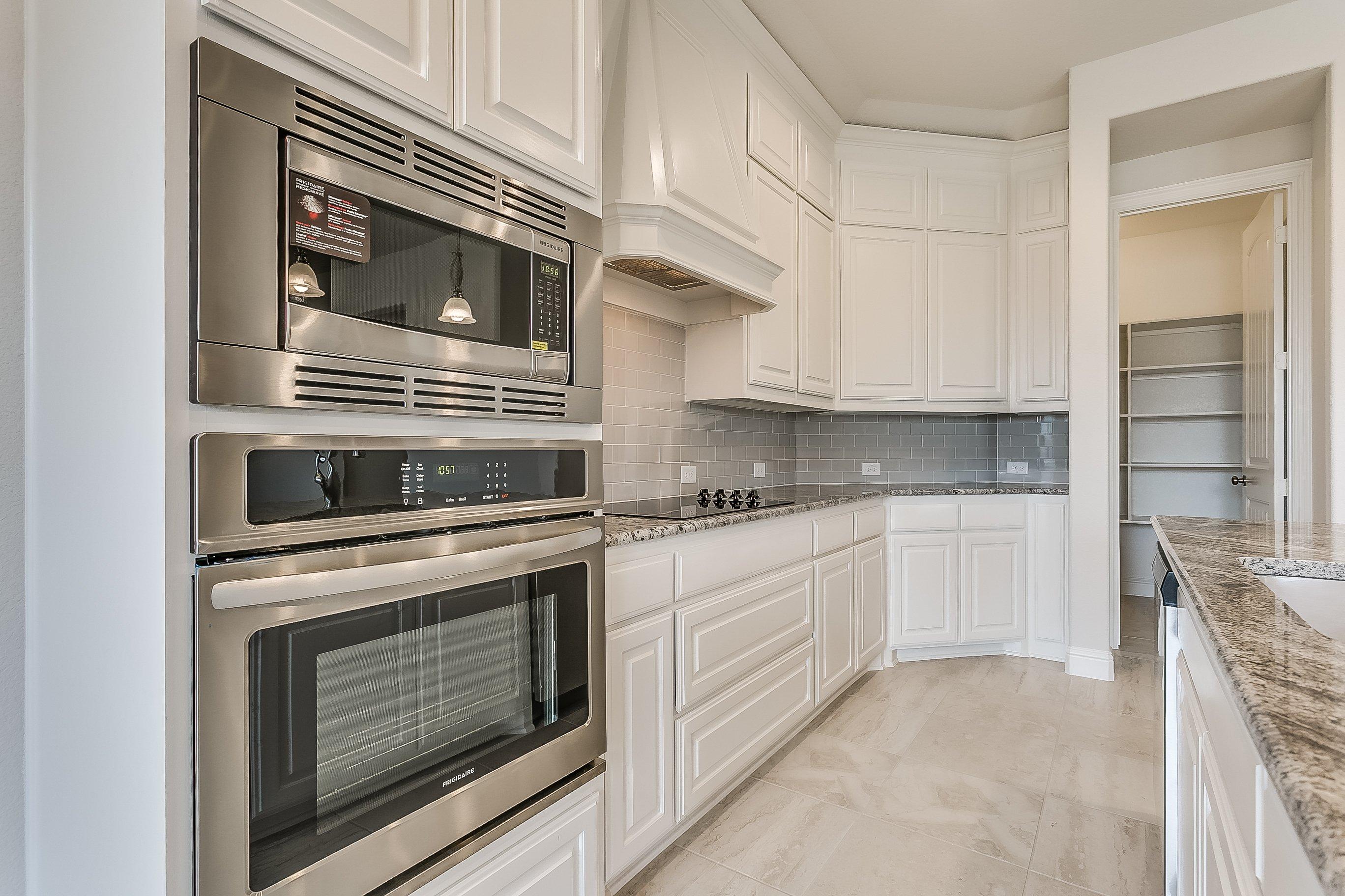 1113 Autumn Trail - John Houston Custom Homes - kitchen, custom cabinets, farmhouse, built in appliances, large pantry