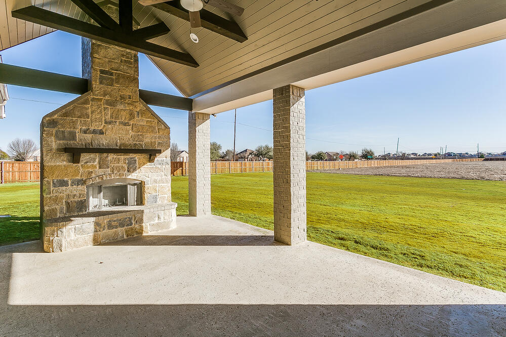 outdoor patio, outdoor fireplace, outdoor space, new homes for sale, john houston custom homes, floor plans, customization, midlothian, waxahachie, mansfield, arlington, burleson, waco, hewitt, mcgregor
